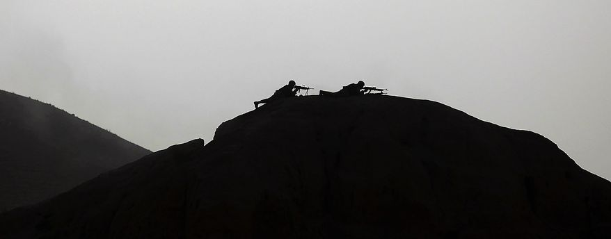 United States Marines from Bravo Company of the 1st Battalion of the 2nd Marines fire machine guns for suppression during a gunbattle as part of an operation to clear the area of insurgents near Musa Qaleh, in northern Helmand Province, southern Afghanistan, Friday, July 23, 2010. (AP Photo/Kevin Frayer)