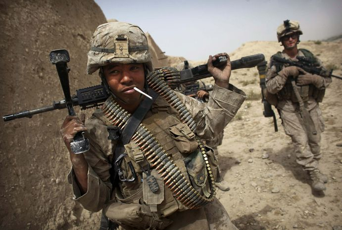 United States Marine LCpl. Brian Quinnones from Bravo Company of the 1st Battalion of the 2nd Marines has an unlit cigarette in his mouth following a gun battle as part of an operation to clear the area of insurgents near Musa Qaleh, in northern Helmand Province, southern Afghanistan, Friday, July 23, 2010. (AP Photo/Kevin Frayer)