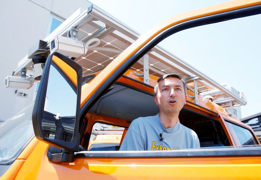 """Project leader Alberto Broggi sits in an unmanned electric-powered vehicle in Parma. """"We would like now to do a long experiment and try this technology for 24 hours a day, with diverse temperatures and traffic, to see if our systems recognize these situations,"""" Mr. Broggi said. (Associated Press)"""