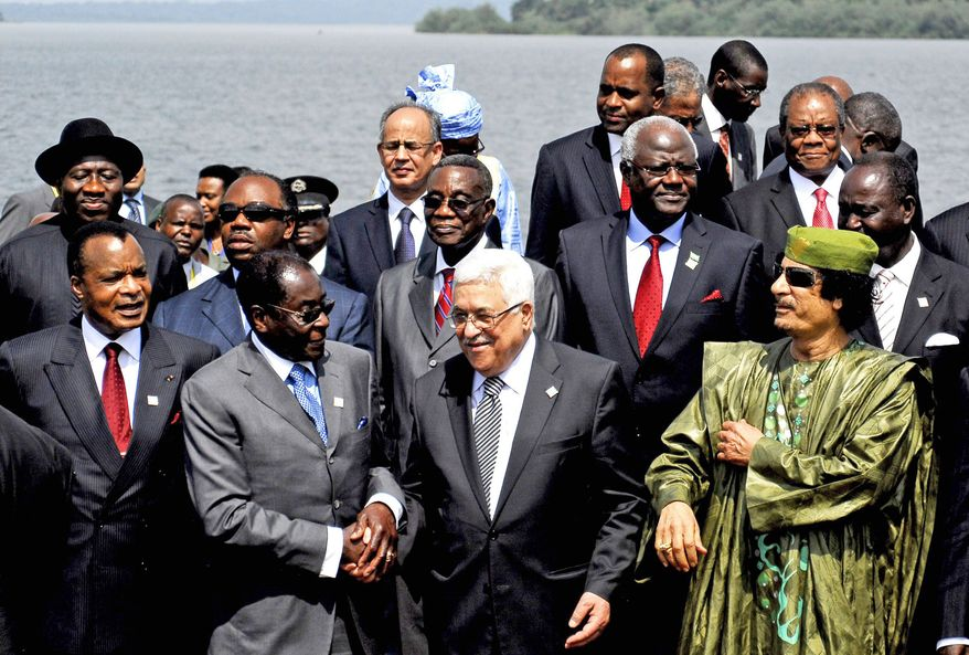 From left to right in the front row, Blaise Compaore of Burkina Faso, Robert Mugabe of Zimbabwe, Mahmoud Abbas of the Palestinian Authority and Moammar Gadhafi of Libya join other presidents for a group photograph near Lake Victoria for the opening of the African Union Summit in Kampala, Uganda, on Sunday. (Associated Press)