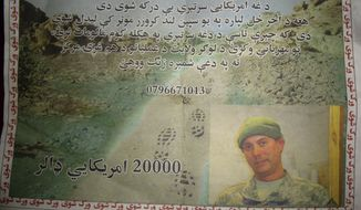 "A leaflet distributed Sunday by the U.S. military to civilians in Logar province, east of Kabul, Afghanistan, shows a missing U.S. Navy sailor with an offer of a $20,000 for information on his whereabouts. The leaflet reads: ""This American troop is missing. He was last seen in a white Land Cruiser vehicle. If you have any information about this solider, kindly contact the Logar Joint Coordination Center."" U.S. and NATO officials confirmed that two American Navy personnel disappeared Friday in the eastern province of Logar, after an armored sports utility vehicle was seen driving into a Taliban-held area. (Associated Press)"