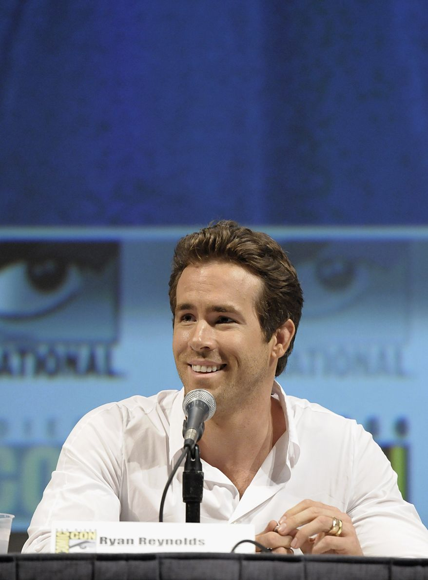 """Actor Ryan Reynolds speaks at a panel discussion of his feature film """"Green Lantern"""" at Comic Con in San Diego, Calif. on Saturday, July 24, 2010. (AP Photo/Dan Steinberg)"""