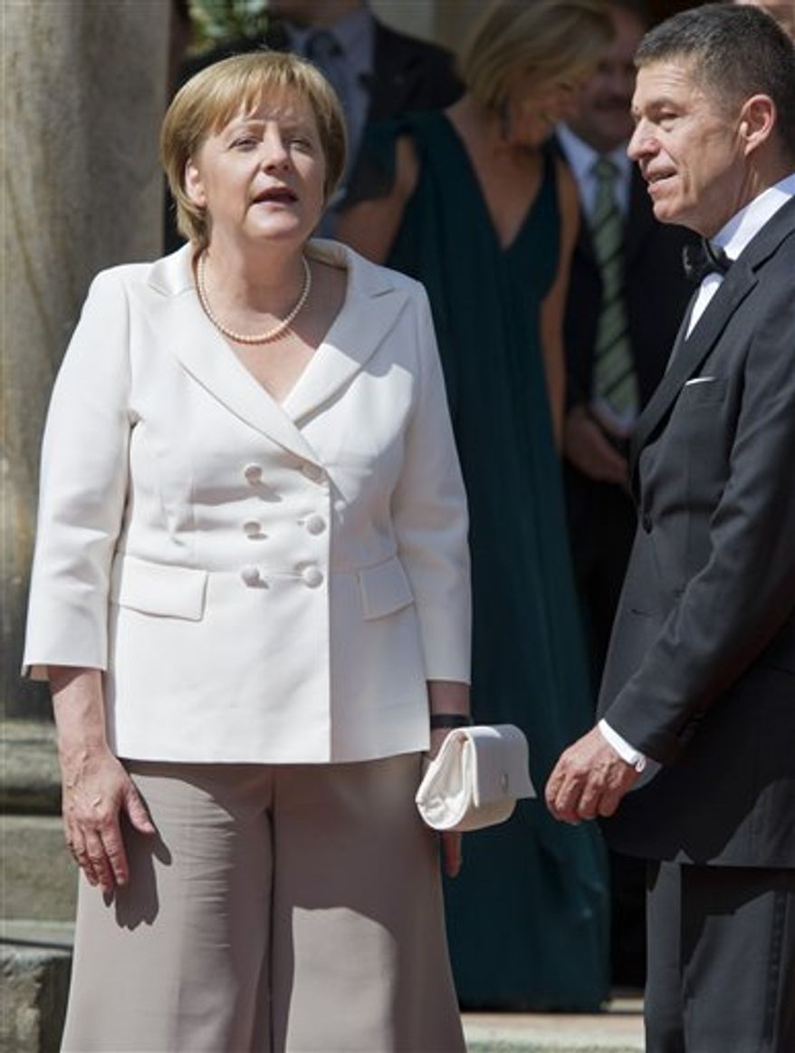 German Chancellor Angela Merkel and her husband Joachim Sauer, right, arrive at  the opening of the Wagner Opera  Festival   in front of the Festspielhaus theatre in Bayreuth, Germany,Sunday, July 25, 2010. (AP Photo/dapd/Eckehard Schulz)