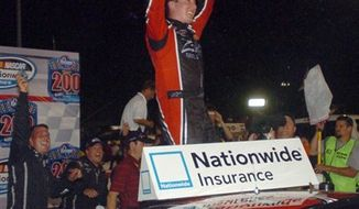 Kyle Busch celebrates after winning the Kroger  200 at O'Reilly Raceway Park, in Clermont,Ind,  Saturday July 24, 2010. (AP Photo/The Star,Greg  Griffo )