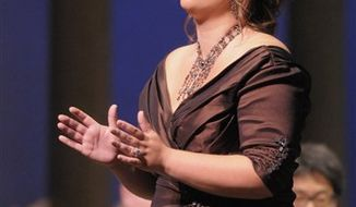 "In this photo released by the Caramoor International Music Festival, soprano Jennifer Rowley, center, acknowledges applause following her performance in Donizetti's ""Maria Di Rohan,"" Saturday, July 24, 2010 in Katonah, N.H. In the front row are, left to right, mezzo-soprano Vanessa Cariddi, baritone Scott Bearden, tenor Luciano Botelho, Rowley, conductor Will Crutchfield, and baritone Jorell Williams. The Orchestra of St. Luke's is behind them. (AP Photo/Gabe Palacio, Caramoor Internatonal Music Festival)"