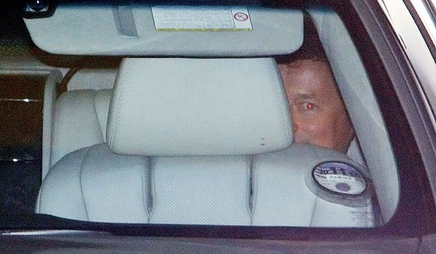 BP Chief Executive Officer Tony Hayward leaves the oil company's offices in London on Monday in the back of a car. He became the face of BP's failure to contain the Gulf of Mexico oil spill and will step down in October. (Associated Press)