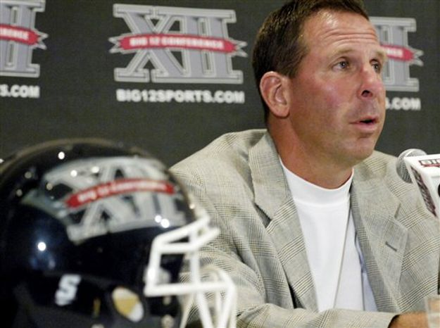 University of Nebraska head coach Bo Pelini answers reporter's questions during the 2010 Big 12 Football Media Day in Monday, July 26, 2010 in Irving, Texas. (AP Photo/Cody Duty)