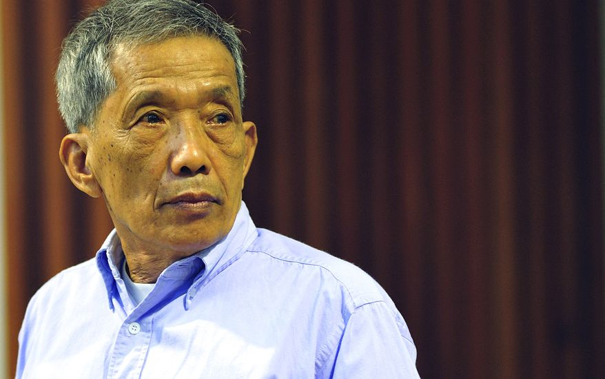 """In this photo released by the Extraordinary Chambers in the Courts of Cambodia, Kaing Guek Eav, also known as Duch, who ran the notorious Toul Sleng, a top secret detention center for the worst """"enemies"""" of the state, looks on Monday during his sentencing at the U.N.-backed war crimes tribunal in Phnom Penh, Cambodia. The U.N.-backed tribunal has found the former Khmer Rouge chief jailer guilty of war crimes and crimes against humanity and ordered him to serve 19 years in prison. (Associated Press/Extraordinary Chambers in the Courts of Cambodia)"""