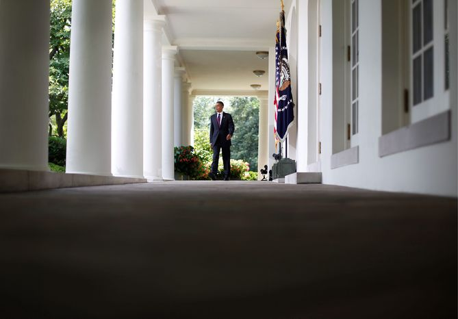"President Obama exits the Oval Office on his way to the Rose Garden at the White House on Monday to deliver remarks on campaign finance reform. ""A vote to oppose these reforms is nothing less than a vote to allow corporate and special-interest takeovers of our elections. It is damaging to our democracy,"" Mr. Obama said. (Associated Press)"