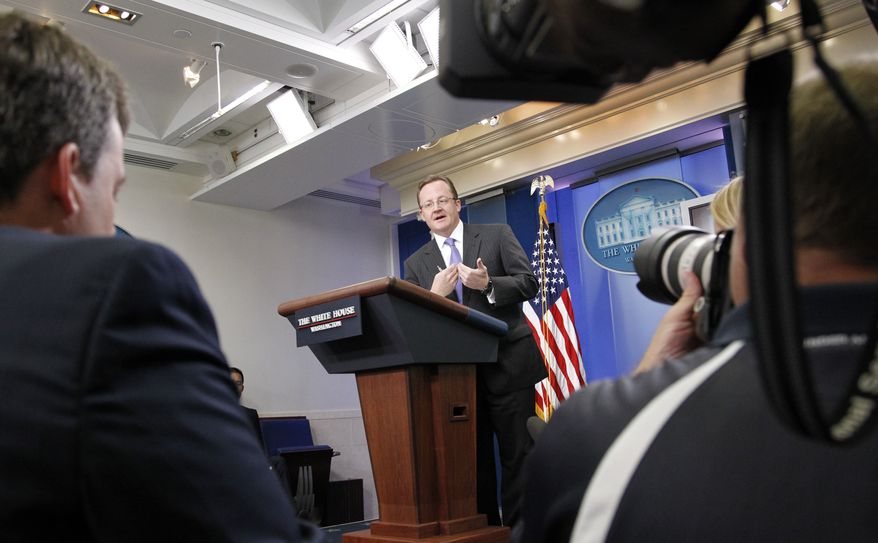 White House press secretary Robert Gibbs answers a question Monday during the daily news briefing at the White House. (Associated Press)