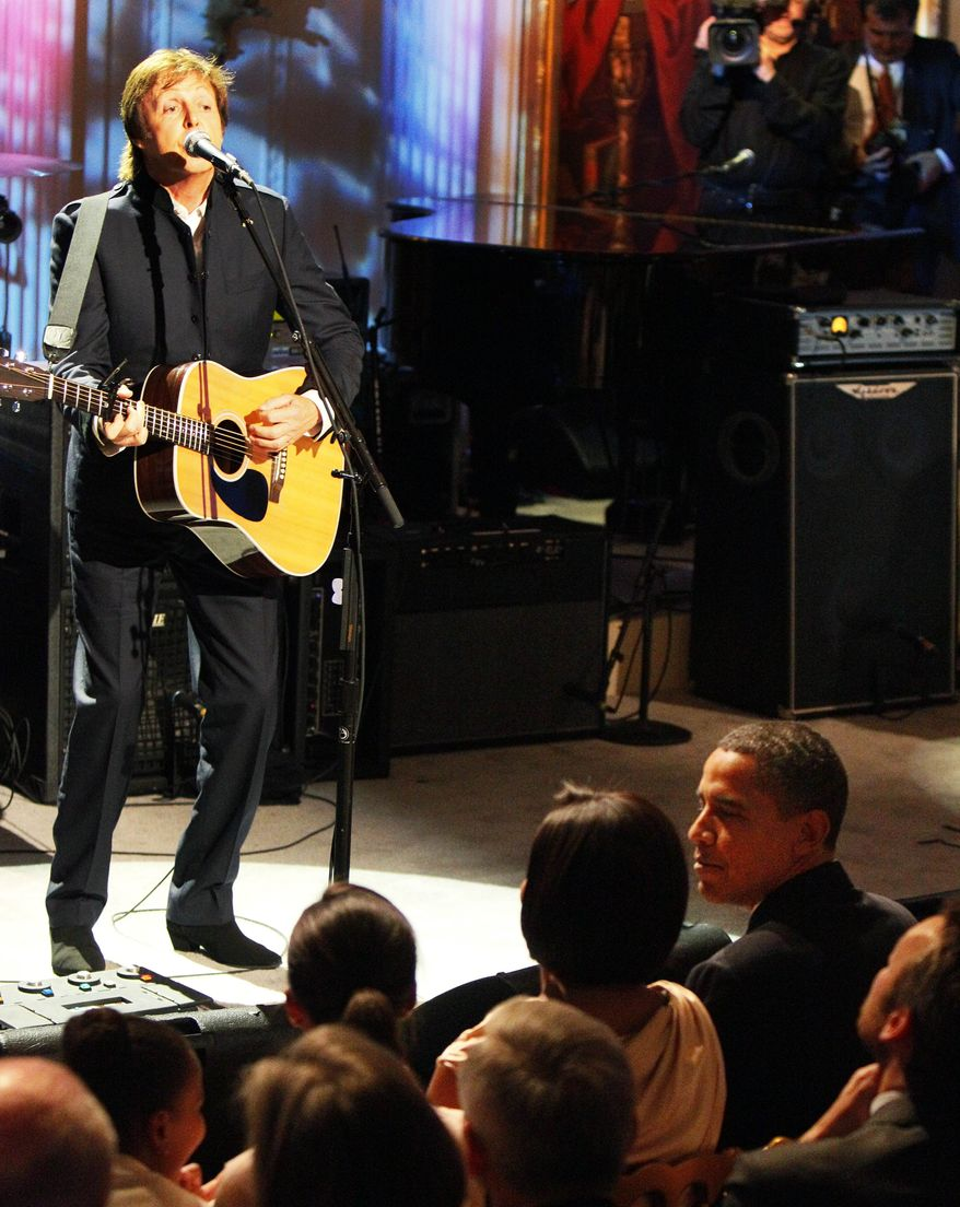 """** FILE ** In this June 2, 2010 file photo, Paul McCartney plays """"Michelle"""" in front of President Barack Obama, right, and first lady Michelle Obama, in the East Room of the White House in Washington. (AP Photo/Alex Brandon, file)"""
