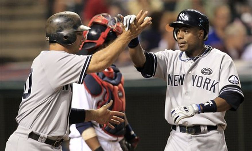New York Yankees' Alex Rodriguez bends over after striking out in the eighth inning in a baseball game against the Cleveland Indians, Thursday, July 29, 2010, in Cleveland. (AP Photo/Tony Dejak)
