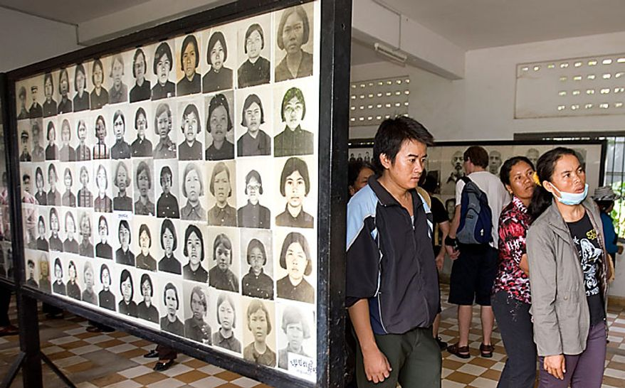 "In this July 22, 2010 photo, Cambodian villagers tour the Tuol Sleng genocide museum, former Khmer Rouge S-23 prison, in Phnom Penh, Cambodia. A war crimes tribunal convicted and sentenced the Khmer Rouge's chief jailer Monday July 26, 2010, for overseeing the deaths of up to 16,000 people, in the first verdict involving a senior member of the ""killing fields"" regime that devastated a generation of Cambodians. (AP Photo/Heng Sinith)"