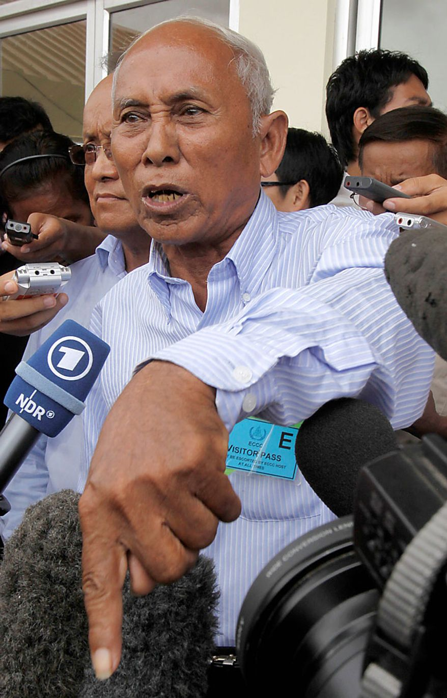 Chum Mey reacts outside the court hall after a verdict was handed down to Kaing Gek Eav, alias Duch, former S-23 prison commander, at the U.N.-backed war crimes tribunal l in Phnom Penh, Cambodia, Monday, July 26, 2010. The tribunal sentenced the former Khmer Rouge chief jailer Monday to 35 years in prison _ the first verdict involving a leader of the genocidal regime that destroyed a generation of Cambodia's people. (AP Photo/Heng Sinith)