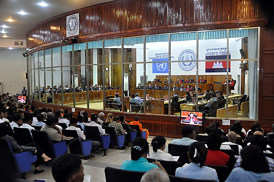 "In this photo released by the Extraordinary Chambers in the Courts of Cambodia, spectators watch the sentencing of Kaing Guek Eav, also known as Duch, who ran the notorious Toul Sleng, a top secret detention center for the worst ""enemies"" of the state, at the U.N.-backed war crimes tribunal in Phnom Penh, Cambodia, Monday, July 26, 2010. The U.N.-backed tribunal found the former Khmer Rouge chief jailer guilty of war crimes and crimes against humanity and ordered him to serve 19 years in prison. (AP Photo/Extraordinary Chambers in the Courts of Cambodia)"