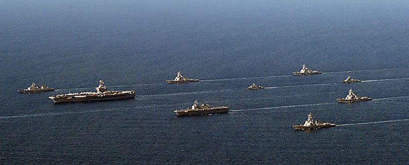 In this photo released by the South Korean Navy, the U.S. nuclear-powered aircraft carrier the USS George Washington, largest, leads a group of South Korean and U.S. warships in formation during joint military drills in South Korea's East Sea on Monday, July 26, 2010. U.S. and South Korean warships and helicopters practiced anti-submarine maneuvers off the Korean Peninsula Monday that officers said they hope would serve as a warning to Pyongyang that aggression in the region would not be tolerated.(AP Photo/South Korean Navy)