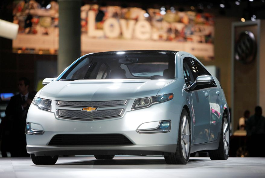 The 2011 Chevrolet Volt electric car will cost $41,000 before government rebates when it goes on sale - about $8,000 more than its closest rival, the all-electric Nissan Leaf. (Associated Press)