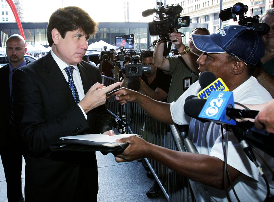 Ousted Illinois Gov. Rod R. Blagojevich talks with Darrell Murphy as he arrives at federal court Tuesday for closing arguments in his corruption trial. The case now is in the jury's hands. (AP Photo)
