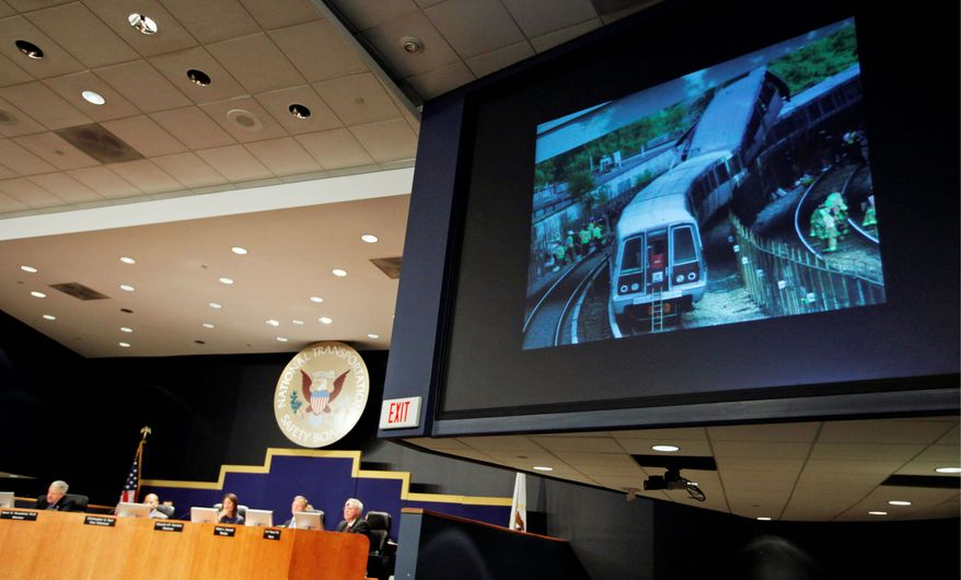SAFETY LAST? A photograph depicting the June 22, 2009, collision of two Metro trains in Northeast Washington that killed nine and injured 52 is shown at a hearing Tuesday on the National Transportation Safety Board's findings. (Associated Press)