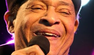 FILE - Seven-time Grammy Award winner, Al Jarreau, performs at Festival Jazz des Cinq Continents in Marseille, France, in this file photo dated July 21, 2010. The 70-year old singer Jarreau has been discharged from hospital, it is announced Sunday Aug.1, 2010, after he suffered from breathing problems in the Alps July 23, and was placed in intensive care. (AP Photo/Claude Paris, File)