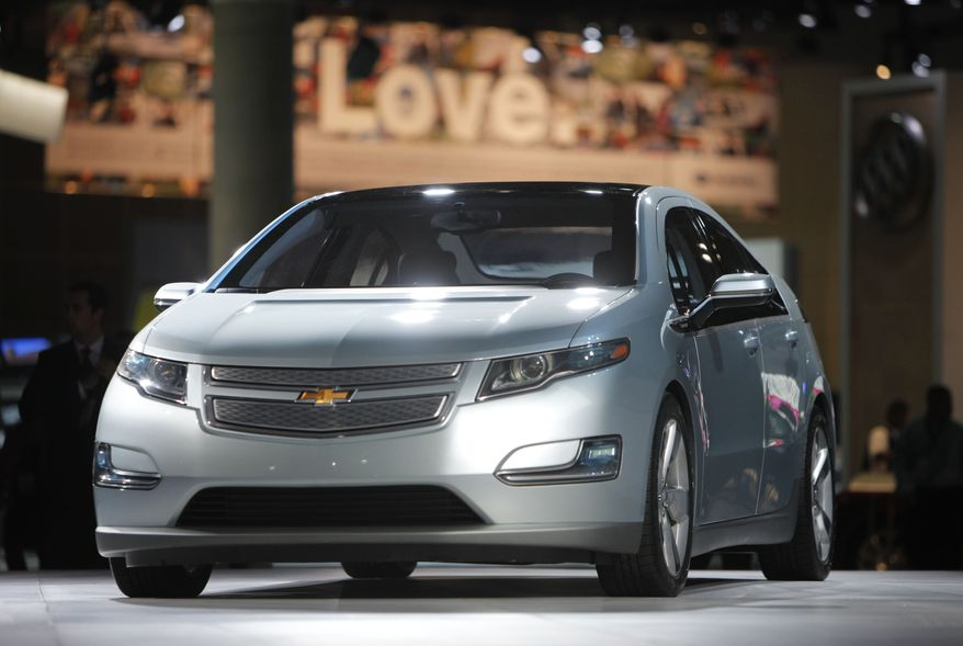 In this file photograph taken Dec. 2, 2009, the 2011 Chevrolet Volt debuts at the Los Angeles Auto Show, in Los Angeles. General Motors Co. said Tuesday, July 27, 2010, its Chevrolet Volt electric car will cost $41,000 when it goes on sale in November. The price is about $8,000 more than its closest rival, the all-electric Nissan Leaf.(AP Photo/Jae C. Hong, file)