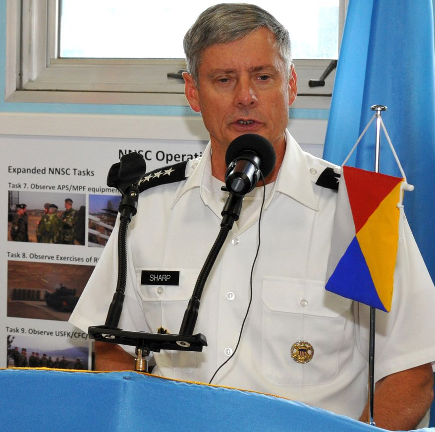 U.S. Army Gen. Walter Sharp, commander of the United Nations Command, speaks at the Neutral Nations Supervisory Commission building in the cross-border village of Panmunjeom in Korea's Demilitarized Zone on Tuesday, July 27, 2010, to mark the 57th anniversary of the signing the Korean War armistice. (AP Photo/Kim Jae-hwan, Pool)