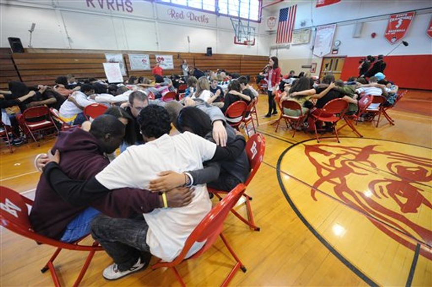 "In this April 29, 2010 publicity image released by MTV, students from Rancocas Valley Regional High School in Mount Holly, N.J., participate in a Challenge Day program during filming of the MTV series ""If You Really Knew Me,"" premiering Tuesday, July 20, 2010 at 11:00 p.m. EST on MTV.  Challenge Day aims to spread awareness and understanding of diversity to inspire change. (AP Photo/MTV, Brad Barket)"