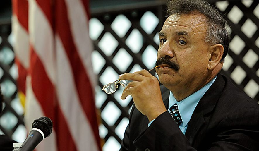 ** FILE ** Bell, Calif., Mayor Oscar Hernandez listens to public comments during a City Council meeting addressing city leaders' pay on July 26, 2010. (AP Photo/Chris Pizzello)
