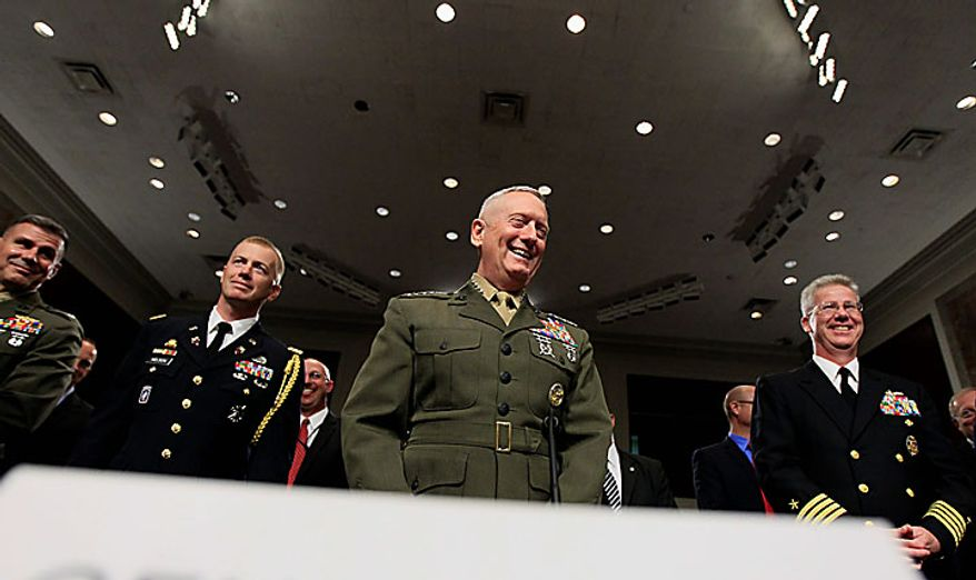 U.S. Central Command Commander-nominee Marine Corps Gen. James Mattis, center, smiles on Capitol Hill in Washington, Tuesday, July 27, 2010, prior to testifying before the Senate Armed Services Committee hearing on his nomination. (AP Photo/Alex Brandon)