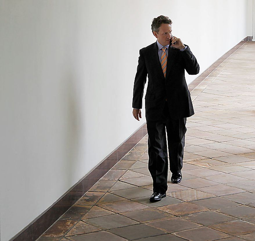 Treasury Secretary Timothy Geithner talks on his cell phone as he walks towards the West Wing of the White House in Washington, Tuesday, July 27, 2010.  (AP Photo/Pablo Martinez Monsivais)