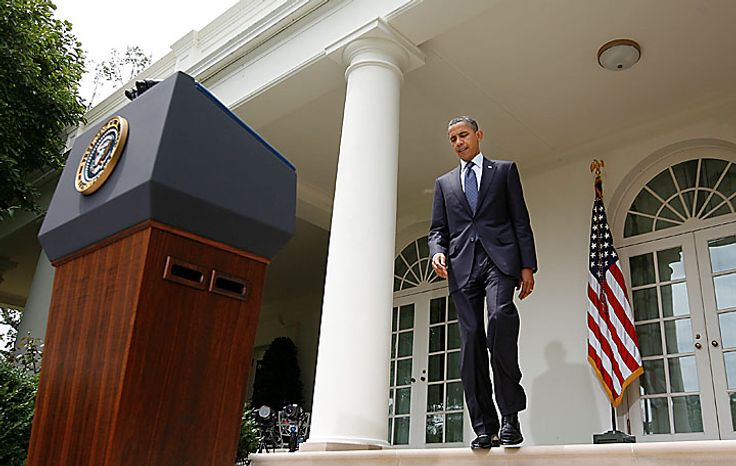 President Barack Obama walks out of the Oval Office to the Rose Garden of the White House in Washington, Tuesday, July 27, 2010, to deliver remarks. (AP Photo/Pablo Martin