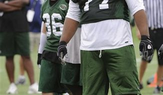 FILE - In this June 14, 2010, file photo, New York Jets defensive tackle Kris Jenkins (77) smiles during the football minicamp in Florham Park, N.J. Jenkins is shedding weight one cookie at a time.  The New York Jets' hefty nose tackle tells The Associated Press he has lost about 20 pounds since starting the popular Dr. Siegal's Cookie Diet in May.  (AP Photo/Bill Kostroun, File)