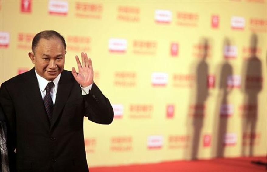 File - In this Saturday, June 13, 2009 file photo, Hong Kong film director John Woo poses on the red carpet prior to the opening ceremony of the 12th Shanghai International Film Festival at Shanghai Grand Theater in Shanghai, China. Woo is the first celebrity to join the cast of the second major film in the leading Chinese state film studio's campaign to reform the propaganda genre with a heavy dose of star power. (AP Photo/Eugene Hoshiko, File)