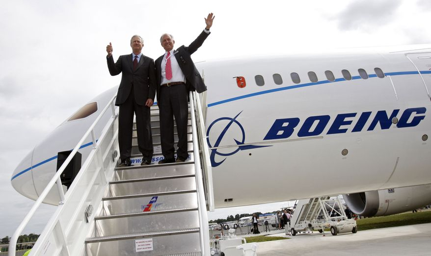 ** FILE ** Boeing Co. Chief Executive Officer Jim McNerney (right) and Jim Albaugh, chief executive officer of Boeing Commercial Airplanes, pose with a Boeing 787 after it landed for the first time outside the United States in Farnborough, England, on July 18, 2010. (AP Photo/Sang Tan, file)