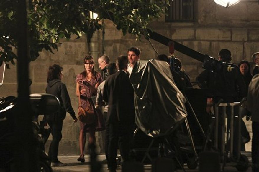 """French President Nicolas Sarkozy's wife Carla Bruni Sarkozy is pictured during filming of a scene of the movie """"Midnight in Paris"""", directed by Woody Allen, in Paris, Wednesday, July 28, 2010. (AP Photo/Thibault Camus)"""
