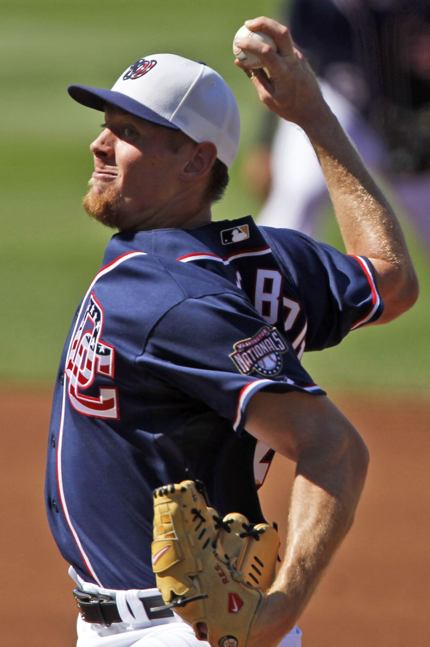 Washington Nationals starter Stephen Strasburg throws a pitch during the first inning of a baseball game against the New York Mets at Nationals Park in Washington on Saturday, July 3, 2010. (AP Photo/Alex Brandon)