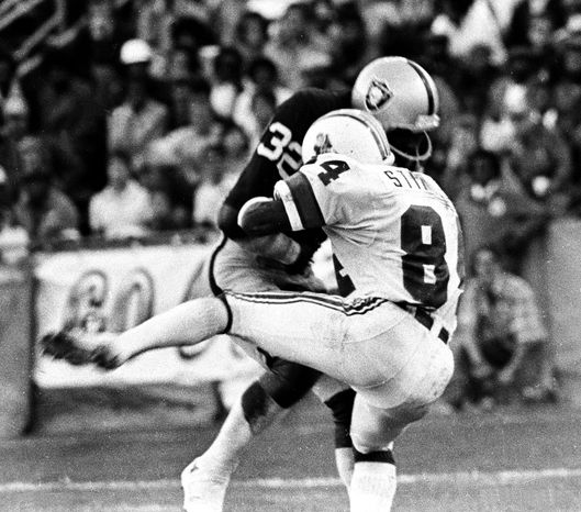 ** FILE ** This Aug. 12, 1978 file photo shows Oakland Raider's Jack Tatum (32) hitting New England Patriots receiver Darryl Stingley (84) during an NFL preseason football game in Oakland, Calif. Tatum, the All-Pro safety for the Oakland Raiders best known for his hit that paralyzed Darryl Stingley in an NFL preseason game in 1978, has died. He was 61. (AP Photo/Oakland Tribune, Ron Riesterer, file)