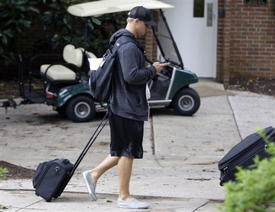 Carolina Panthers quarterback Jimmy Clausen arrives for the beginning of the NFL football team's training camp in Spartanbrug, S.C., Wednesday, July 28, 2010. (AP Photo/Chuck Burton)