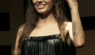 "U.S. actress Angelina Jolie smiles during a press conference to promote her new spy action-thriller ""Salt"" in Seoul, South Korea, Wednesday, July 28, 2010. (AP Photo/Ahn Young-joon)"