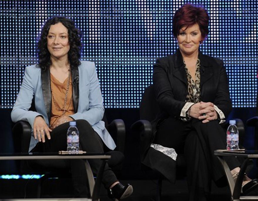 "Sara Gilbert, left, a co-host and executive producer of new CBS show ""The Talk,"" participates in a panel discussion with fellow co-host Sharon Osbourne at the CBS, Showtime and The CW Television Critics Association summer press tour in Beverly Hills, Calif., Wednesday, July 28, 2010. (AP Photo/Chris Pizzello)"