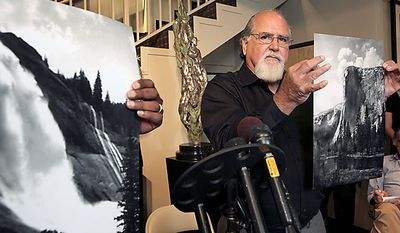 Rick Norsigian holds up a photograph made from a glass negative shot by the late photographer Ansel Adams during a press conference in Beverly Hills on Tuesday July 27,2010. A lawyer says the trove of old glass negatives found in a garage sale for $45 by Mr. Norsigian, a painter from Fresno, Calif., has been authenticated as the work of photographer Ansel Adams and are worth at least $200 million. (AP Photo/Nick Ut)