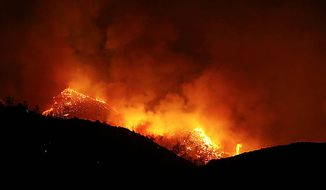 ** FILE ** Bright flames light up the side of this hill, north of Kernville, Calif., Tuesday, July 27, 2010. A fire in Sequoia National Forest has destroyed six homes, charred eight square miles and forced the evacuation of 122 juvenile offenders attending a forestry camp near the California town of Kernville. (AP Photo/The Bakersfield Californian, Casey Christie)