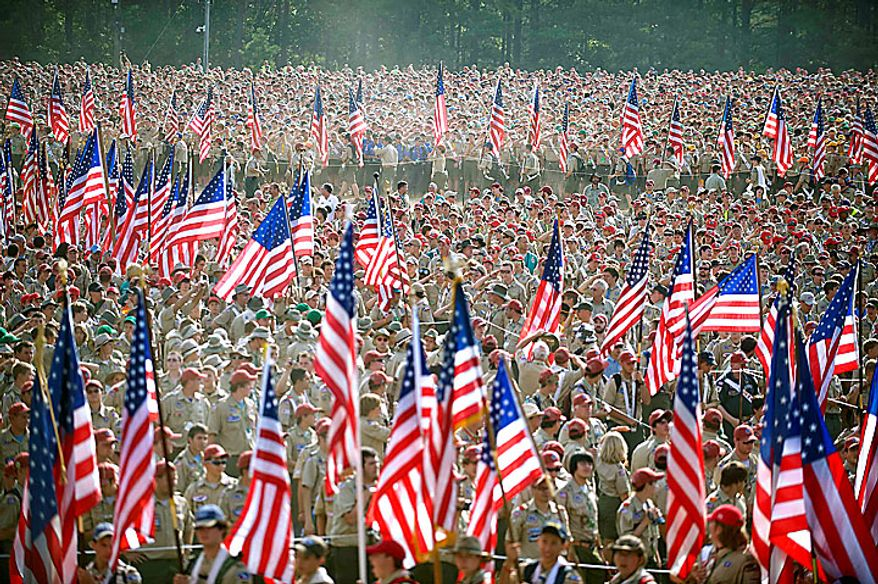 In a Wednesday, July 28, 2010 photo provided by the Department of Defense, Boy Scouts from across America march with flags for the playing of the national anthem during the Boy Scouts of America 2010 National Scout Jamboree at Ft. AP Hill, Va. U.S. Defense Secretary Robert Gates addressed an audience of more than 45,000 who came to the 12,000 acre site for 10 days to celebrate the Boy Scouts' 100-year anniversary. (AP Photo/DOD, Cherie Cullen)