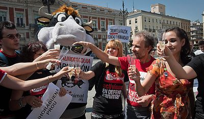 Animal rights activists toast with sparkling wine to celebrate Catalonia's parliament decision to ban bullfights on their northeastern region, in Madrid on Wednesday, July 28, 2010. Lawmakers in Catalonia outlawed bullfighting Wednesday, making it Spain's first major region to do so after an impassioned debate that pitted the rights of animals against preserving a pillar of traditional culture. (AP Photo/Daniel Ochoa de Olza)
