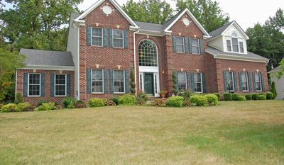 The brick-front home at 12705 Woodbridge Court in Bowie's Woodmore South is on the market for $637,000.