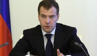 Russian President Dmitry Medvedev speaks to the Cabinet at a meeting, in Moscow's Kremlin, Tuesday, June 29, 2010. (AP photo/RIA Novosti, Vladimir Rodionov, Presidential Press Service)