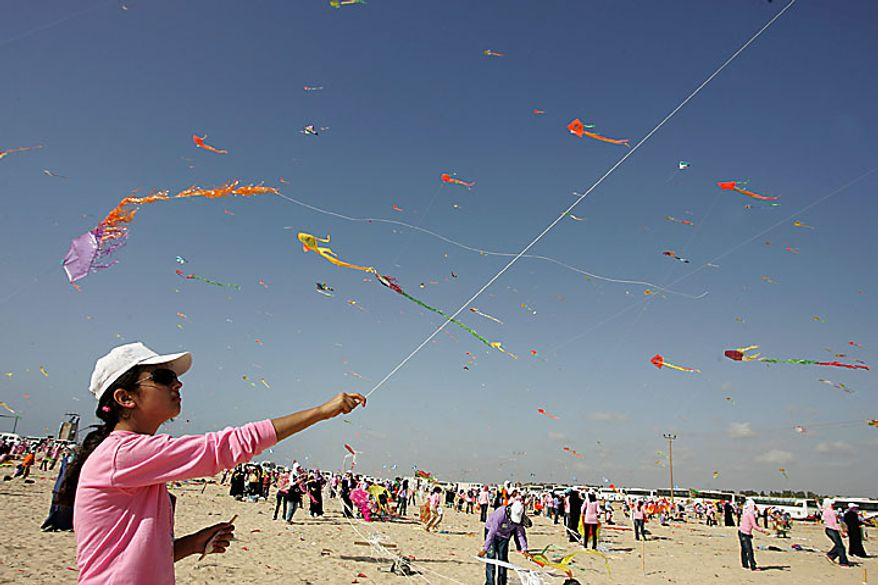 Thousands of Palestinian children fly kites along the beach during a U.N.-sponsored summer camp in the northern Gaza Strip on Thursday, July 29, 2010. The children claimed a world record, flying thousands of kites at the same time. About 8,000 children attended in the event, Khalil el-Halabi, education program head at the U.N. Relief and Works Agency, said. (UPI/Ismael Mohamad)
