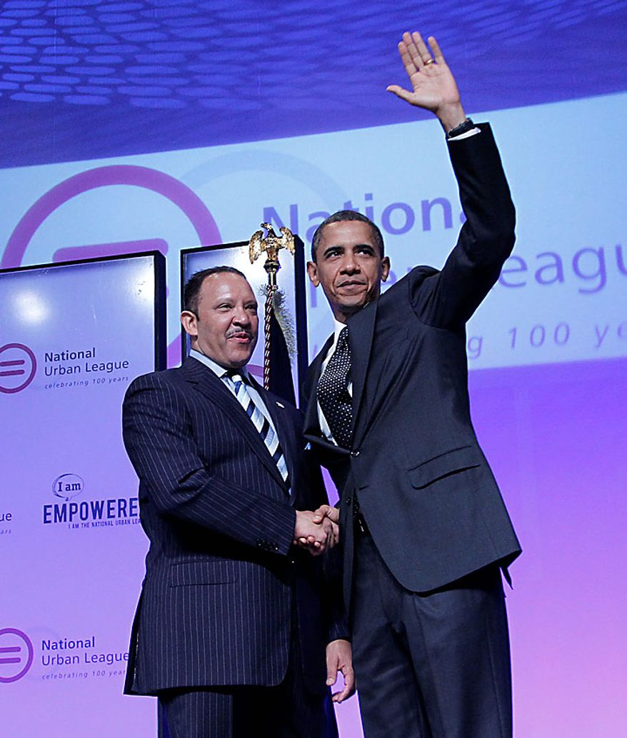 President Barack Obama is greeted by National Urban League President and CEO Marc Morial before delivering remarks at the National Urban League 100th Anniversary Convention in Washington, Thursday, July 29, 2010. (AP Photo/Pablo Martinez Monsivais)