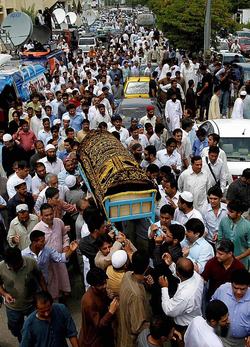 Mourners carry the caskets of victims of Wednesday's plane crash during a funeral prayer in Karachi, Pakistan, on Thursday, July 29, 2010. The Airbus A321 operated by Pakistani carrier Airblue crashed into hills overlooking the country's capital, Islamabad, during stormy monsoon weather, killing all 152 people on board. (AP Photo/Shakil Adil)