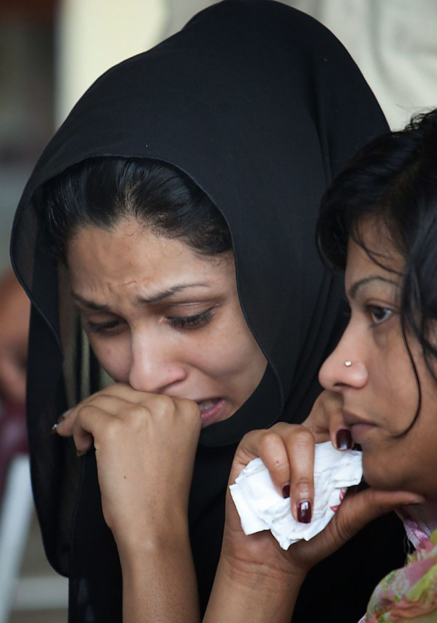 Grieving family members of passengers killed in Wednesday's plane crash wait at a community center on Thursday, July 29, 2010, in Islamabad, Pakistan, to give blood for DNA testing. The Airbus A321 operated by Pakistani carrier Airblue crashed into hills overlooking the country's capital, Islamabad, during stormy monsoon weather, killing all 152 people on board. (AP Photo/B.K. Bangash)